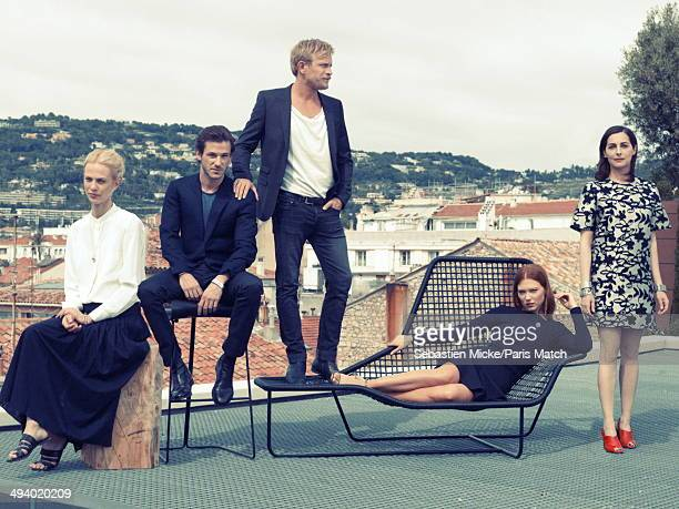 Actors of the film Saint Laurent by Bertrand Bonello Aymeline Valade Gaspard Ulliel Jeremie Renier Lea Seydoux Amira Casar pose during the 67th...