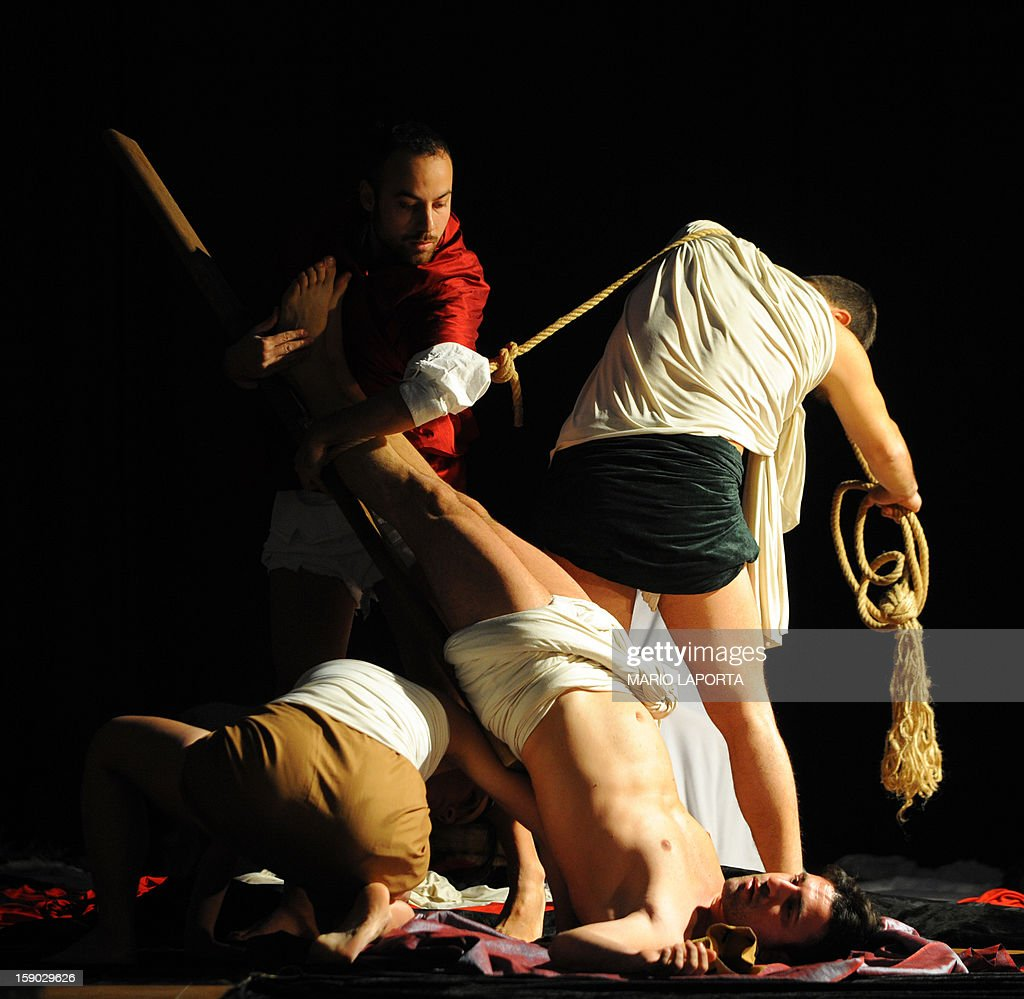 Actors of the 'Ludovica Carambelli Theater' company perform as they form a representation of Caravaggio's painting 'Crocefissione di Pietro', during the 'Tableaux Vivants' ('Living Paintings') event at the Diocesan Museum in Naples on January 6, 2013. The theather company's performance involves forming living representations of 21 different paintings by the famous Italian artist. AFP PHOTO / MARIO LAPORTA