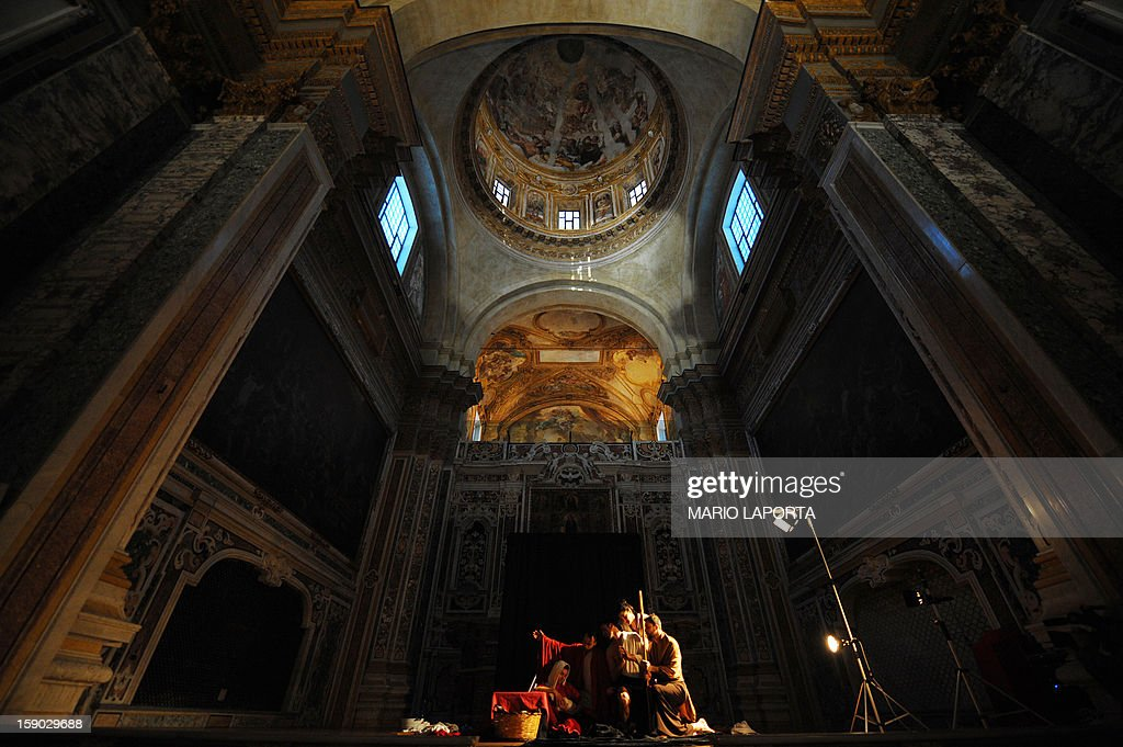 Actors of the 'Ludovica Carambelli Theater' company perform as they form a representation of Caravaggio's painting 'Adorazione dei Pastori', during the 'Tableaux Vivants' ('Living Paintings') event at the Diocesan Museum in Naples on January 6, 2013. The theather company's performance involves forming living representations of 21 different paintings by the famous Italian artist.