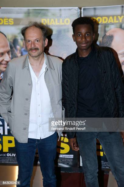 Actors of the movie Denis Podalydes and Abdoulaye Diallo attend the 'Les grands Esprits' Paris Premiere at UGC Cine Cite des Halles on September 5...