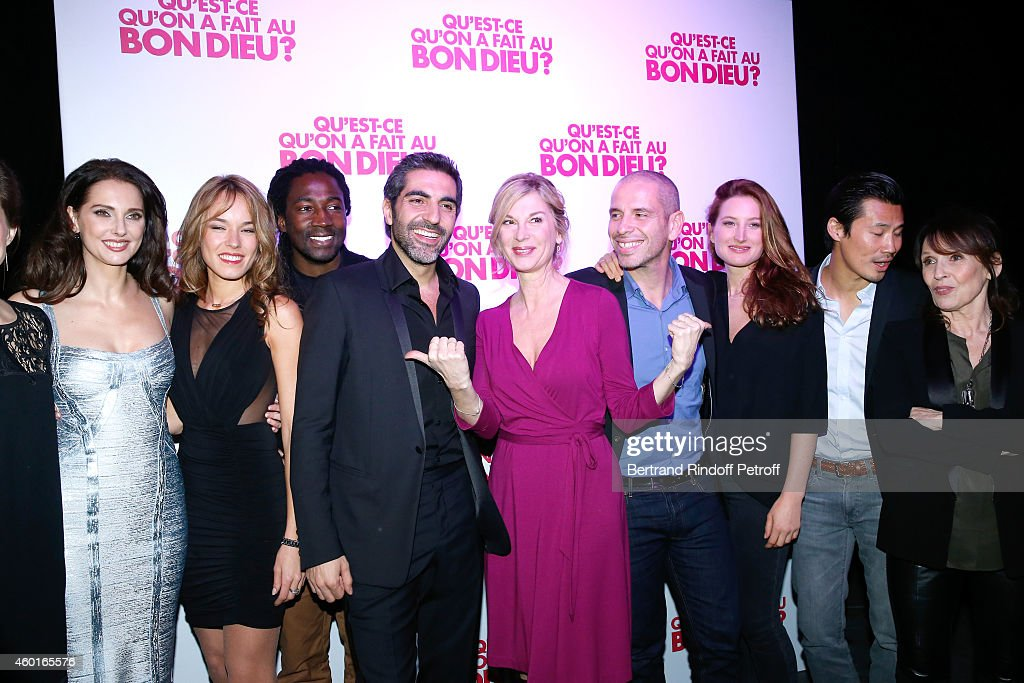 Actors of the movie (L-R) <a gi-track='captionPersonalityLinkClicked' href=/galleries/search?phrase=Frederique+Bel&family=editorial&specificpeople=622597 ng-click='$event.stopPropagation()'>Frederique Bel</a>, Elodie Fontan, Noom Diawara, <a gi-track='captionPersonalityLinkClicked' href=/galleries/search?phrase=Ary+Abittan&family=editorial&specificpeople=5678005 ng-click='$event.stopPropagation()'>Ary Abittan</a>, <a gi-track='captionPersonalityLinkClicked' href=/galleries/search?phrase=Michele+Laroque&family=editorial&specificpeople=593269 ng-click='$event.stopPropagation()'>Michele Laroque</a>, Medi Sadoun, Julia Piaton, Frederic Chau and <a gi-track='captionPersonalityLinkClicked' href=/galleries/search?phrase=Chantal+Lauby&family=editorial&specificpeople=3948578 ng-click='$event.stopPropagation()'>Chantal Lauby</a> attend the 'Qu'est ce qu'on a fait au Bon Dieu' : Success Party at Le Showcase - Pont Alexandre III on December 8, 2014 in Paris, France.