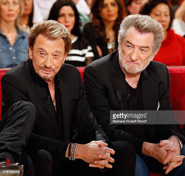 Actors of the movie 'Salaud on t'aime' Johnny Hallyday and Eddy Mitchell attend the 'Vivement Dimanche' French TV show at Pavillon Gabriel on March...