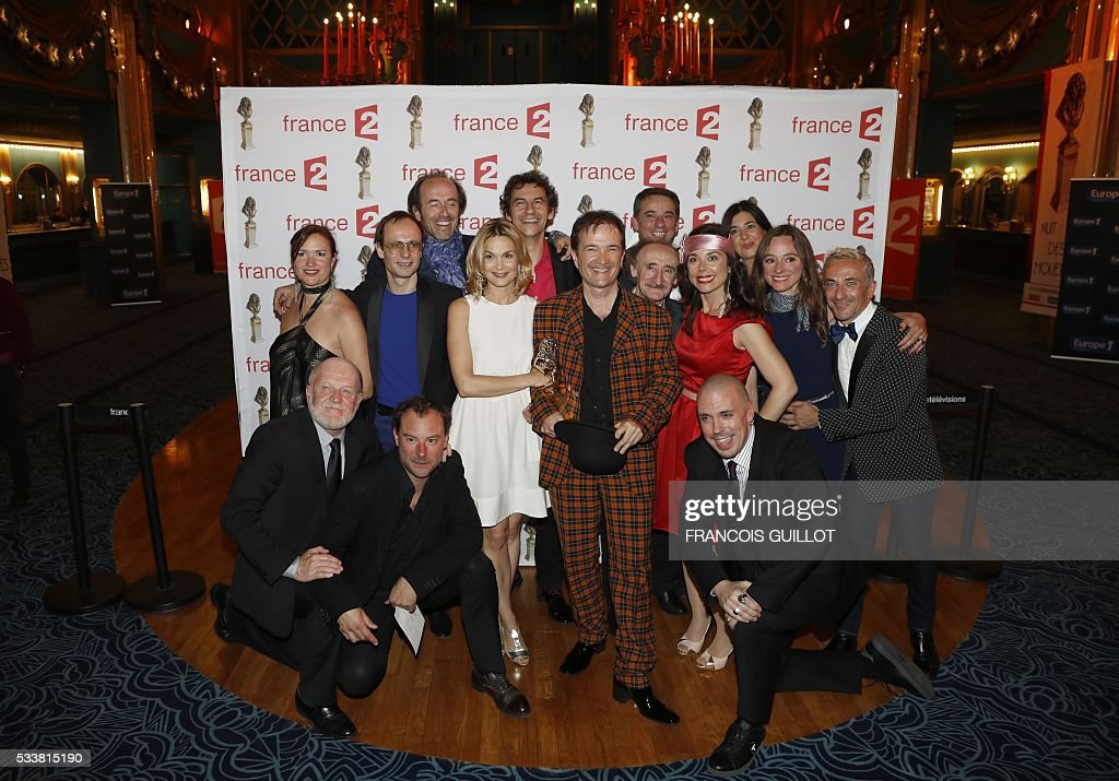 Actors of the play 'Les Faux British' pose after receiving the Moliere Award for the best comedy during the 28th Ceremony of the French Theatre Molieres awards at the Folies Bergers in Paris, on May 23, 2016. GUILLOT
