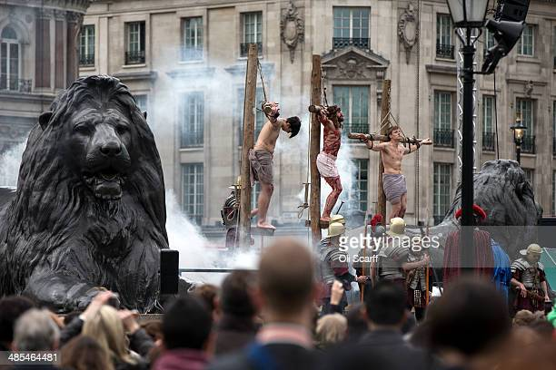 Actors of the Wintershall Players perform 'The Passion of Jesus' on Good Friday to crowds in Trafalgar Square on April 18 2014 in London England The...