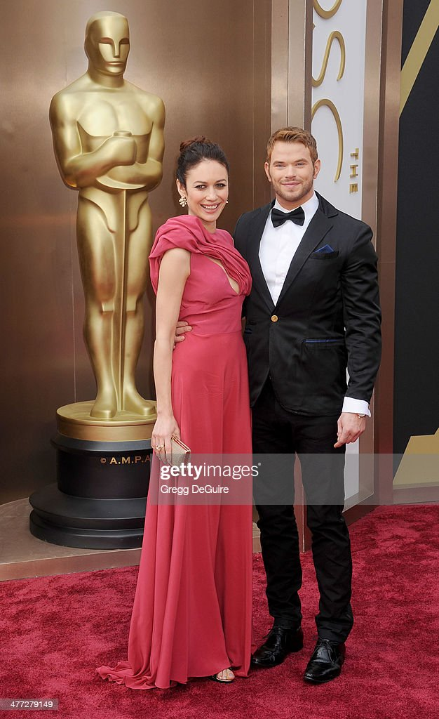Actors Olga Kurylenko and Kellan Lutz arrive at the 86th Annual Academy Awards at Hollywood & Highland Center on March 2, 2014 in Hollywood, California.