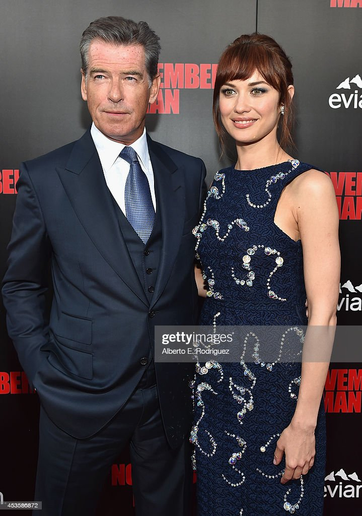 Actors Olga Kurylenko and Pierce Brosnan arrive to the World Premiere of Relativity Media's 'The November Man' at the TCL Chinese Theatre on August...