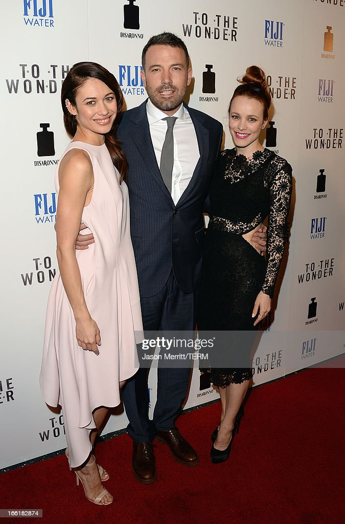 Actors <a gi-track='captionPersonalityLinkClicked' href=/galleries/search?phrase=Olga+Kurylenko&family=editorial&specificpeople=630281 ng-click='$event.stopPropagation()'>Olga Kurylenko</a>, <a gi-track='captionPersonalityLinkClicked' href=/galleries/search?phrase=Ben+Affleck&family=editorial&specificpeople=201856 ng-click='$event.stopPropagation()'>Ben Affleck</a> and <a gi-track='captionPersonalityLinkClicked' href=/galleries/search?phrase=Rachel+McAdams&family=editorial&specificpeople=212942 ng-click='$event.stopPropagation()'>Rachel McAdams</a> attend the premiere of Magnolia Pictures' 'To The Wonder' at Pacific Design Center on April 9, 2013 in West Hollywood, California.