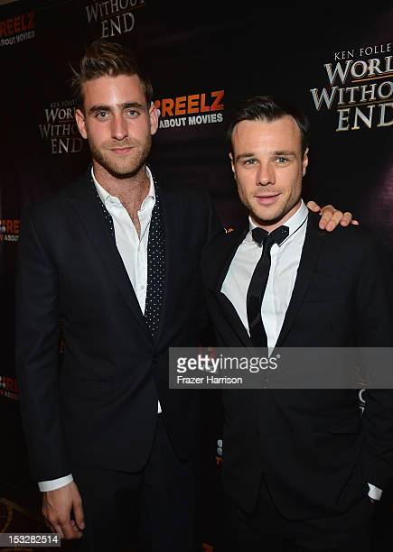 Actors Oliver JacksonCohen and Rupert Evans attend the screening of 'World Without End' presented by ReelzChannel at The Grove on October 2 2012 in...
