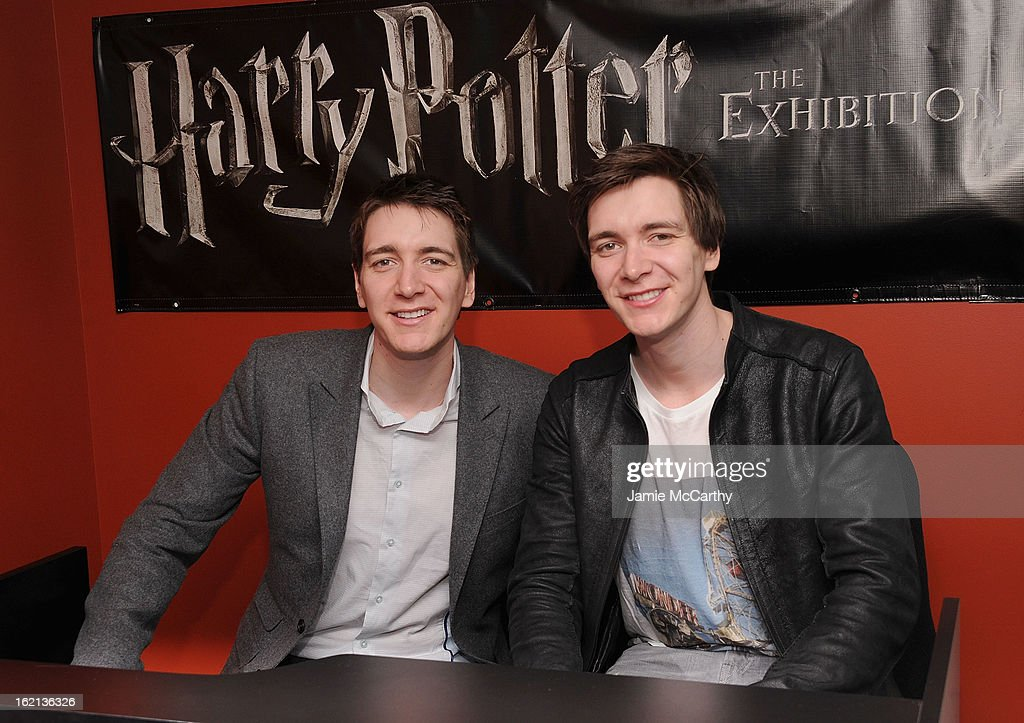 Actors Oliver Phelps and James Phelps visit The Harry Potter Exhibit at Discovery Times Square on February 19, 2013 in New York City.
