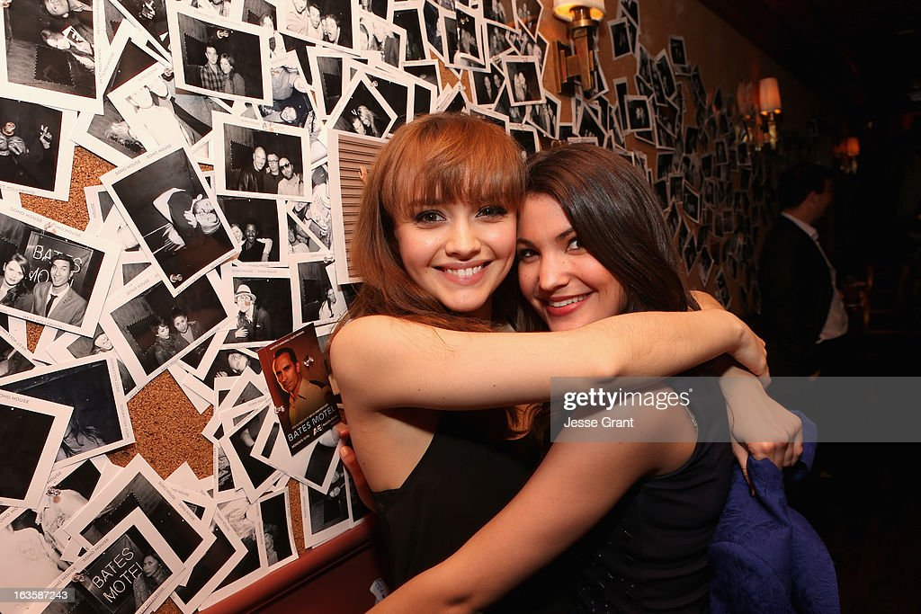 Actors Olivia Cooke and Emmalyn Estrada attend A&E's 'Bates Motel' Premiere Party on March 12, 2013 in West Hollywood, California.