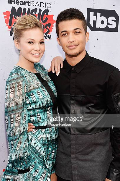Actors Olivia Holt and Jordan Fisher attend the iHeartRadio Music Awards at The Forum on April 3 2016 in Inglewood California