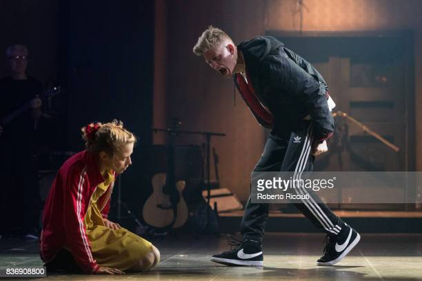 Actors Olivia Morgan and Lorn Macdonald perform on stage 'Oresteia This Restless House' during a photo call at Lyceum Theatre as part of the 70th...