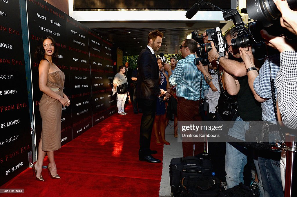 Actors <a gi-track='captionPersonalityLinkClicked' href=/galleries/search?phrase=Olivia+Munn&family=editorial&specificpeople=598969 ng-click='$event.stopPropagation()'>Olivia Munn</a> (L) and <a gi-track='captionPersonalityLinkClicked' href=/galleries/search?phrase=Joel+McHale&family=editorial&specificpeople=754384 ng-click='$event.stopPropagation()'>Joel McHale</a> (C) attend the 'Deliver Us From Evil' screening hosted by Screen Gems & Jerry Bruckheimer Films with The Cinema Society at SVA Theater on June 24, 2014 in New York City.