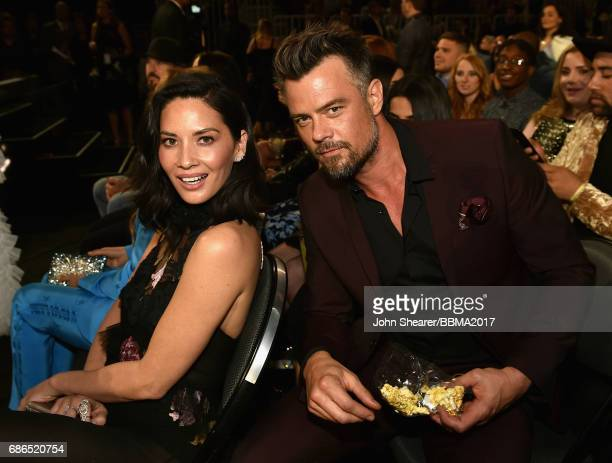 Actors Olivia Munn and Josh Duhamel attend the 2017 Billboard Music Awards at TMobile Arena on May 21 2017 in Las Vegas Nevada