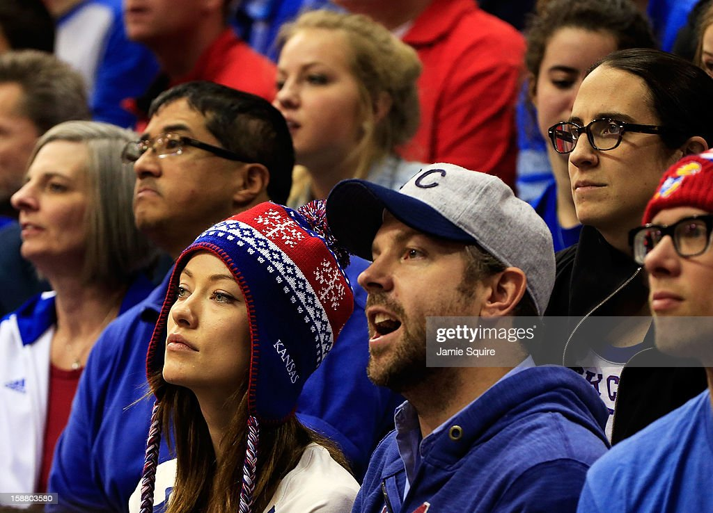 Actors Olivia Wilde and Jason Sudeikis watch from the crowd during the game between the American University Eagles and the Kansas Jayhawks at Allen Fieldhouse on December 29, 2012 in Lawrence, Kansas.