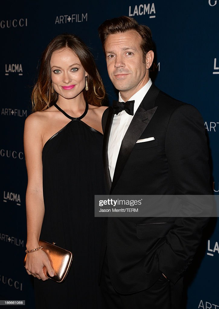 Actors Olivia Wilde and Jason Sudeikis, wearing Gucci, attend the LACMA 2013 Art + Film Gala honoring Martin Scorsese and David Hockney presented by Gucci at LACMA on November 2, 2013 in Los Angeles, California.