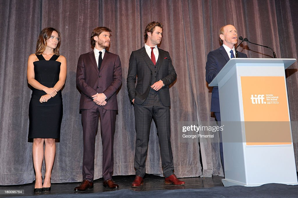 Actors <a gi-track='captionPersonalityLinkClicked' href=/galleries/search?phrase=Olivia+Wilde&family=editorial&specificpeople=235399 ng-click='$event.stopPropagation()'>Olivia Wilde</a>, Daniel Bruhl, <a gi-track='captionPersonalityLinkClicked' href=/galleries/search?phrase=Chris+Hemsworth&family=editorial&specificpeople=646776 ng-click='$event.stopPropagation()'>Chris Hemsworth</a> and director <a gi-track='captionPersonalityLinkClicked' href=/galleries/search?phrase=Ron+Howard+-+Director&family=editorial&specificpeople=201972 ng-click='$event.stopPropagation()'>Ron Howard</a> attend the 'Rush' premiere during the 2013 Toronto International Film Festival at Roy Thomson Hall on September 8, 2013 in Toronto, Canada.