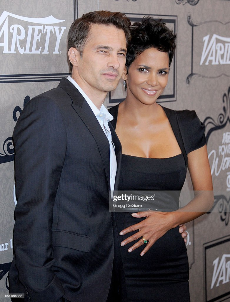 Actors <a gi-track='captionPersonalityLinkClicked' href=/galleries/search?phrase=Olivier+Martinez&family=editorial&specificpeople=213013 ng-click='$event.stopPropagation()'>Olivier Martinez</a> and <a gi-track='captionPersonalityLinkClicked' href=/galleries/search?phrase=Halle+Berry&family=editorial&specificpeople=201726 ng-click='$event.stopPropagation()'>Halle Berry</a> arrive at Variety's 4th Annual Power Of Women event at the Beverly Wilshire Four Seasons Hotel on October 5, 2012 in Beverly Hills, California.