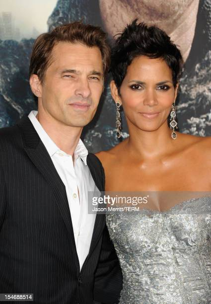 Actors Olivier Martinez and Halle Berry arrive at Warner Bros Pictures' 'Cloud Atlas' premiere at Grauman's Chinese Theatre on October 24 2012 in...