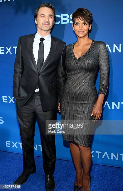 Actors Olivier Martinez and Halle Berry attend Premiere Of CBS Television Studios Amblin Television's 'Extant' at California Science Center on June...