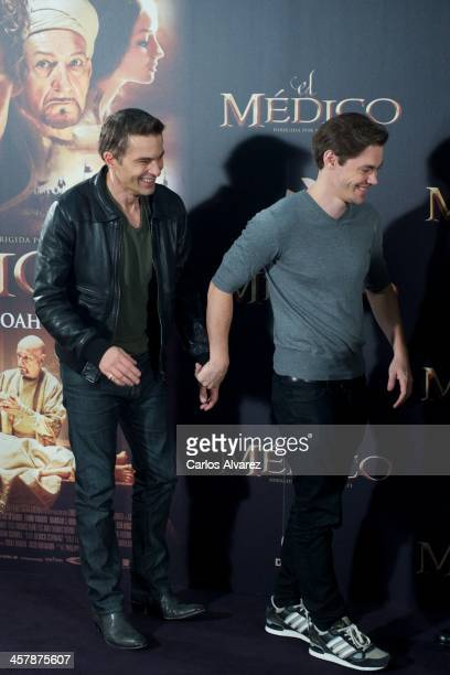 Actors Olivier Martinez and Tom Payne attend the 'The Physician' photocall at the Hotel ME on December 19 2013 in Madrid Spain