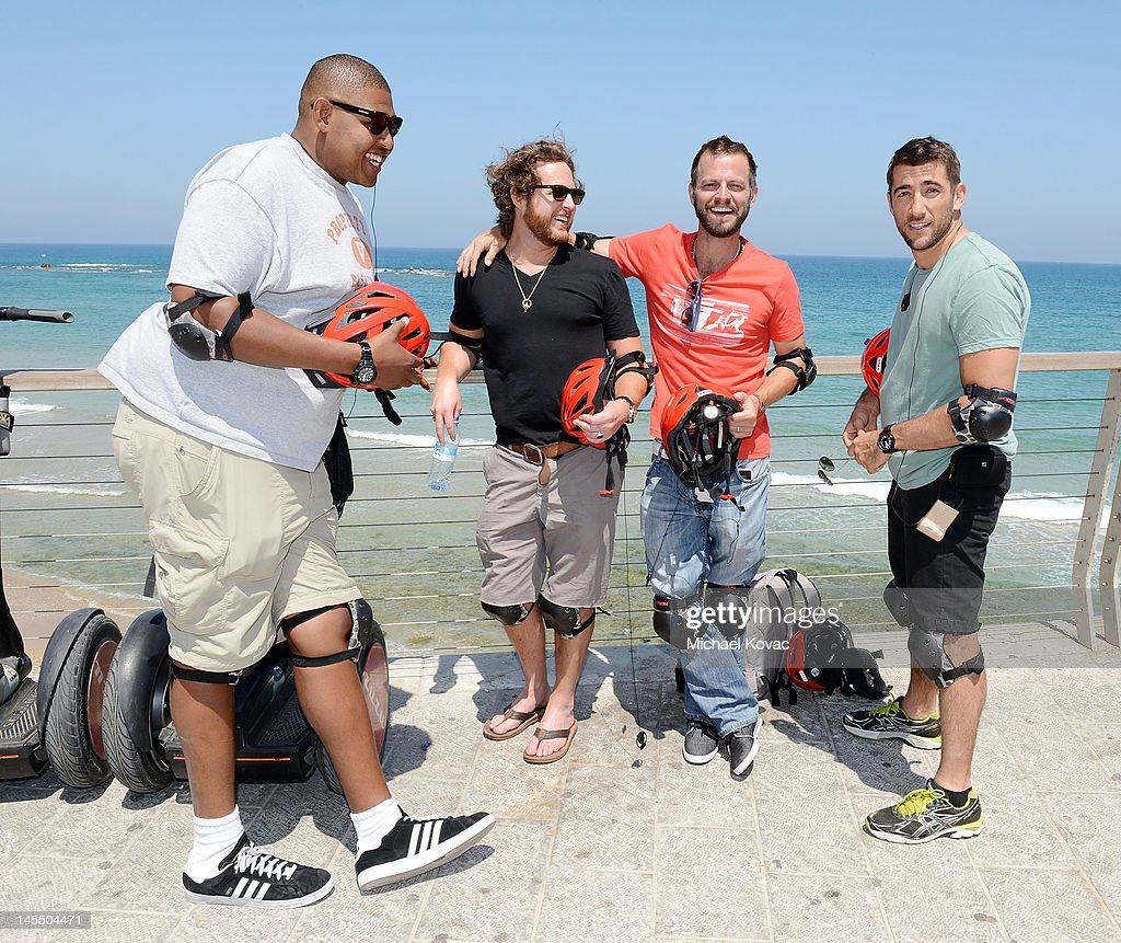 Actors Omar Benson Miller, AJ Buckley, <a gi-track='captionPersonalityLinkClicked' href=/galleries/search?phrase=Carmine+Giovinazzo&family=editorial&specificpeople=225065 ng-click='$event.stopPropagation()'>Carmine Giovinazzo</a>, and <a gi-track='captionPersonalityLinkClicked' href=/galleries/search?phrase=Jonathan+Togo&family=editorial&specificpeople=682661 ng-click='$event.stopPropagation()'>Jonathan Togo</a> take a break during a Segway tour of Tel Aviv on May 31, 2012 in Tel Aviv, Israel.