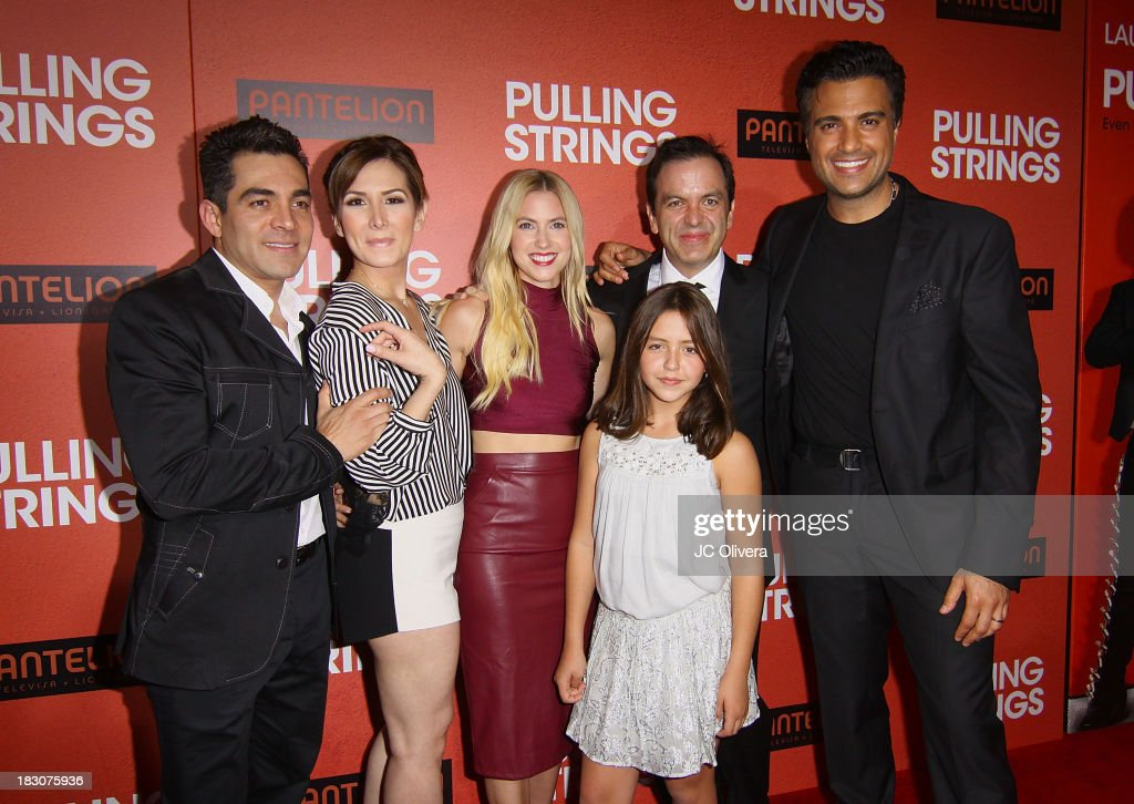 Actors Omar Chaparro, Aurora Papile, <a gi-track='captionPersonalityLinkClicked' href=/galleries/search?phrase=Laura+Ramsey&family=editorial&specificpeople=649583 ng-click='$event.stopPropagation()'>Laura Ramsey</a>, Filmmaker Pitipol Ybarra and Actor <a gi-track='captionPersonalityLinkClicked' href=/galleries/search?phrase=Jaime+Camil&family=editorial&specificpeople=580441 ng-click='$event.stopPropagation()'>Jaime Camil</a> attend Los Angeles Premiere of 'Pulling Strings' at Regal Cinemas L.A. Live on October 3, 2013 in Los Angeles, California.