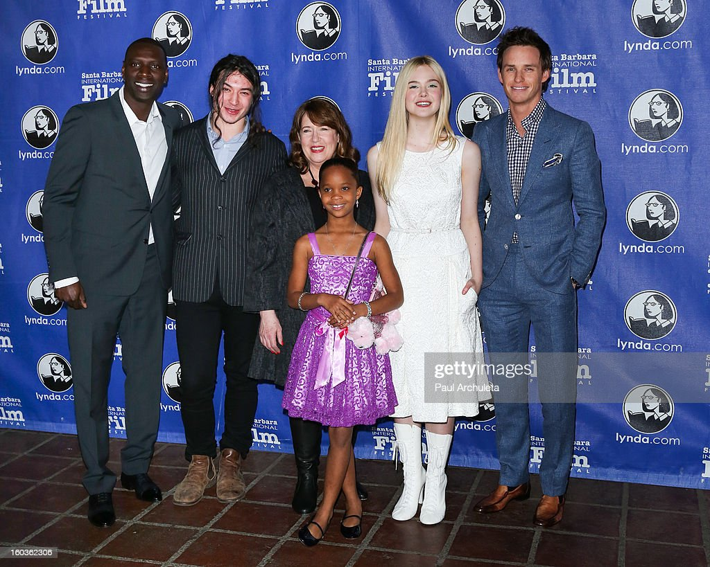 Actors <a gi-track='captionPersonalityLinkClicked' href=/galleries/search?phrase=Omar+Sy&family=editorial&specificpeople=4110364 ng-click='$event.stopPropagation()'>Omar Sy</a>, <a gi-track='captionPersonalityLinkClicked' href=/galleries/search?phrase=Ezra+Miller&family=editorial&specificpeople=5348897 ng-click='$event.stopPropagation()'>Ezra Miller</a>, <a gi-track='captionPersonalityLinkClicked' href=/galleries/search?phrase=Ann+Dowd&family=editorial&specificpeople=3209553 ng-click='$event.stopPropagation()'>Ann Dowd</a>, Quvenzhane Wallis, <a gi-track='captionPersonalityLinkClicked' href=/galleries/search?phrase=Elle+Fanning&family=editorial&specificpeople=2189940 ng-click='$event.stopPropagation()'>Elle Fanning</a> and <a gi-track='captionPersonalityLinkClicked' href=/galleries/search?phrase=Eddie+Redmayne&family=editorial&specificpeople=2554844 ng-click='$event.stopPropagation()'>Eddie Redmayne</a> attend the 28th Santa Barbara International Film Festival Virtuoso Award Ceremony at The Arlington Theatre on January 29, 2013 in Santa Barbara, California.