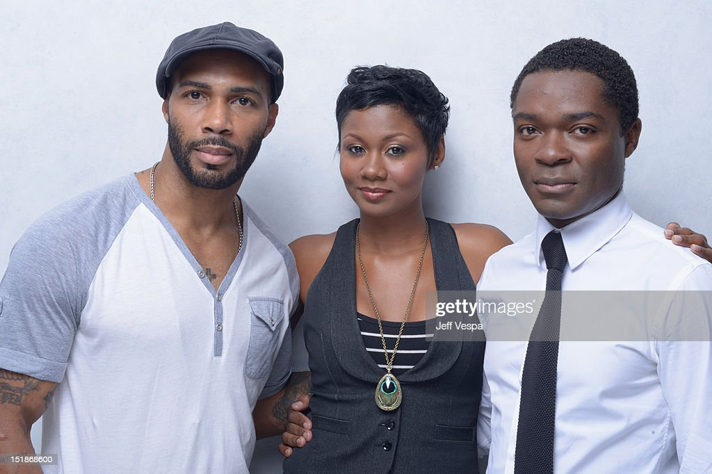 Actors <a gi-track='captionPersonalityLinkClicked' href=/galleries/search?phrase=Omari+Hardwick&family=editorial&specificpeople=4342711 ng-click='$event.stopPropagation()'>Omari Hardwick</a>, Emayatzy Corinealdi and <a gi-track='captionPersonalityLinkClicked' href=/galleries/search?phrase=David+Oyelowo&family=editorial&specificpeople=633075 ng-click='$event.stopPropagation()'>David Oyelowo</a> of 'Middle of Nowhere' pose at the Guess Portrait Studio during 2012 Toronto International Film Festival on September 12, 2012 in Toronto, Canada.