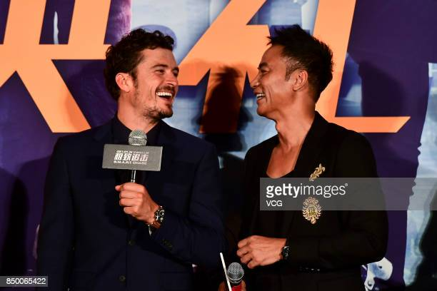 Actors Orlando Bloom and Simon Yam attend 'SMART Chase' premiere at Wanda Cinema on September 20 2017 in Beijing China