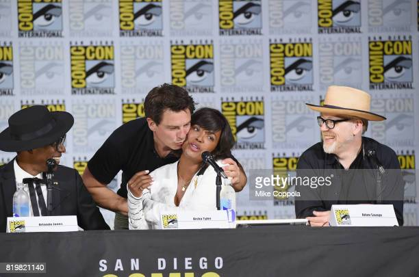 Actors Orlando Jones John Barrowman and Aisha Tyler and TV personality Adam Savage speak onstage at SYFY hosts The Great Debate during ComicCon...