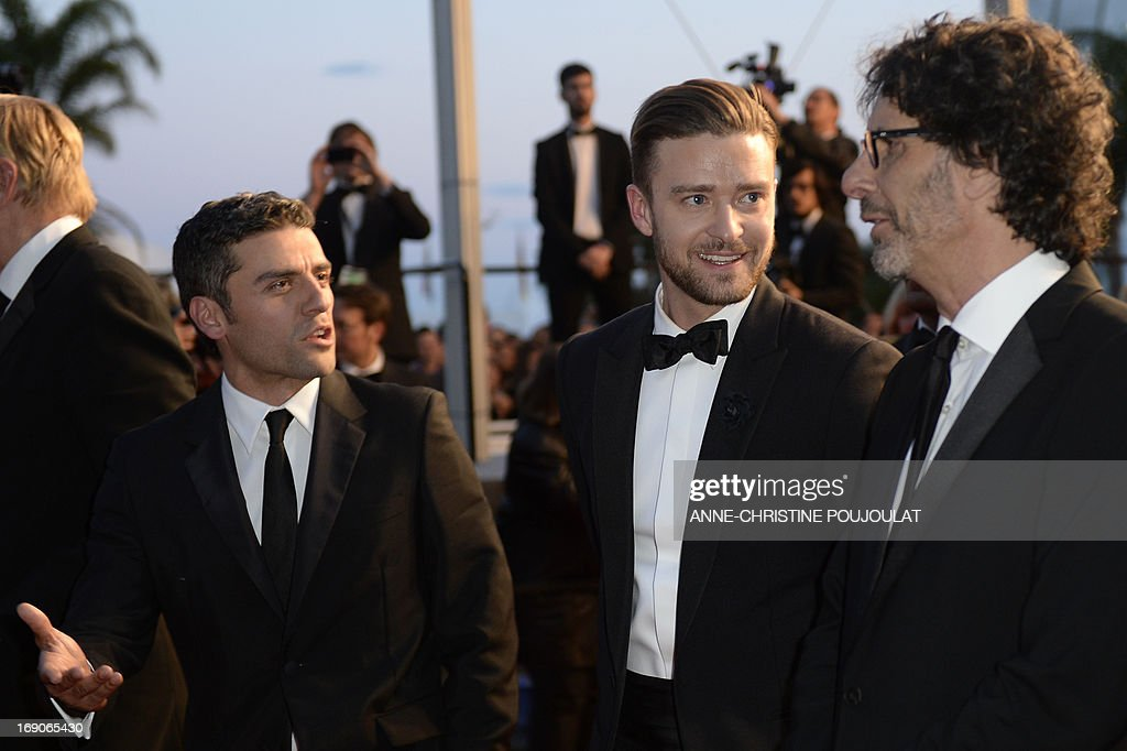 US actors Oscar Isaac and Justin Timberlake and director Joel Coen leave on May 19, 2013 after attending the screening of their film 'Inside Llewyn Davis' presented in Competition at the 66th edition of the Cannes Film Festival in Cannes. Cannes, one of the world's top film festivals, opened on May 15 and will climax on May 26 with awards selected by a jury headed this year by Hollywood legend Steven Spielberg.