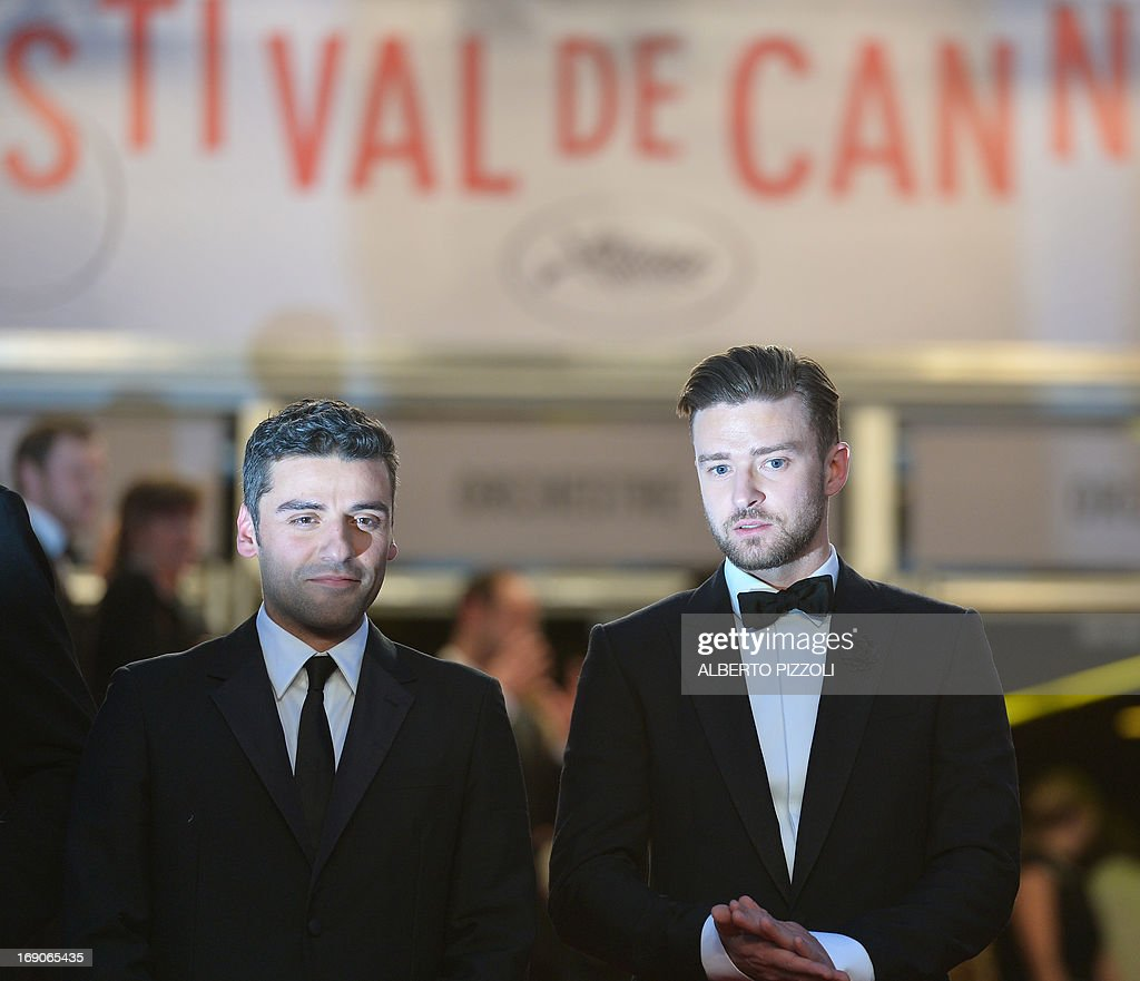 US actors Oscar Isaac (L) and Justin Timberlake pose on May 19, 2013 before leaving following the screening of the film 'Inside Llewyn Davis' presented in Competition at the 66th edition of the Cannes Film Festival in Cannes. Cannes, one of the world's top film festivals, opened on May 15 and will climax on May 26 with awards selected by a jury headed this year by Hollywood legend Steven Spielberg.