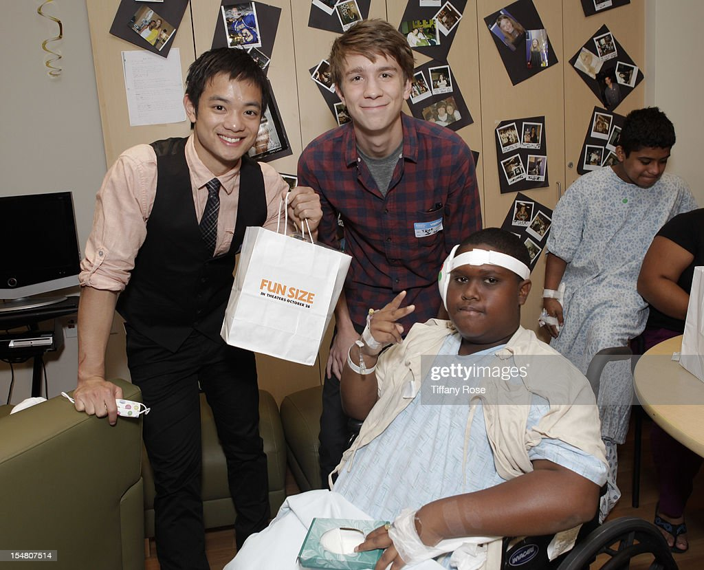 Actors Osric Chau and Thomas Mann pose with a patient at 'Fun Size' Special Screening At Children's Hospital Los Angeles at Childrens Hospital Of Los...