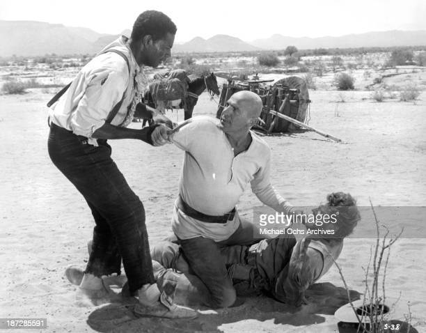 Actors Ossie Davis Telly Savalas and Burt Lancaster on set of the movie 'The Scalphunters' in 1968