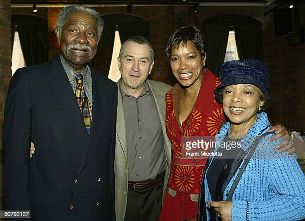 Actors Ozzie Davis and Robert De Niro with Grace Hightower and Ruby Dee attend the VIP Opening Luncheon at the Tribeca Loft May 1 2004 in New York...