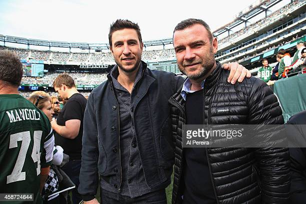 Actors Pablo Schreiber and Liev Schrieber attend the Pittsburgh Steelers vs New York Jets game at MetLife Stadium on November 9 2014 in East...