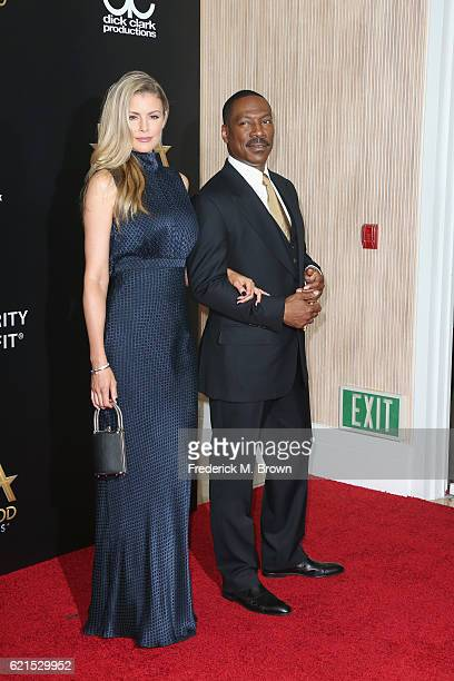 Actors Paige Butcher and Eddie Murphy attend the 20th Annual Hollywood Film Awards on November 6 2016 in Beverly Hills California