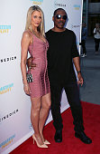 Actors Paige Butcher and Eddie Murphy attend the premiere of Cinedigm's 'Amateur Night' at ArcLight Hollywood on July 25 2016 in Hollywood California