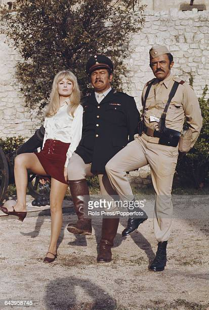 Actors Pamela Tiffin Peter Ustinov and John Astin pictured together in costume on the set of the comedy film 'Viva Max' in Rome Italy on 10th May 1969