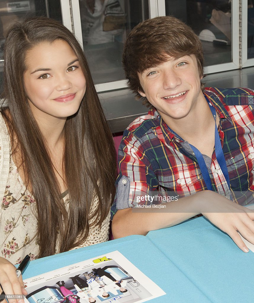 Actors Paris Berelc and Jake Short volunteer at the 14th Annual 'Mattel Party On The Pier' Benefiting Mattel Children's Hospital UCLA at Santa Monica Pier on October 6, 2013 in Santa Monica, California.