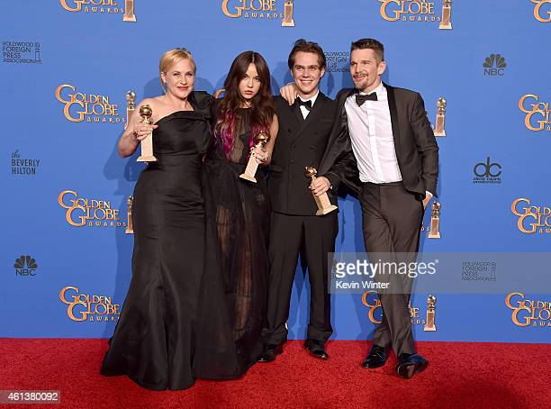 Actors Patricia Arquette Lorelei Linklater Ellar Coltrane and Ethan Hawke winners of Best Motion Picture Drama for 'Boyhood' pose in the press room...