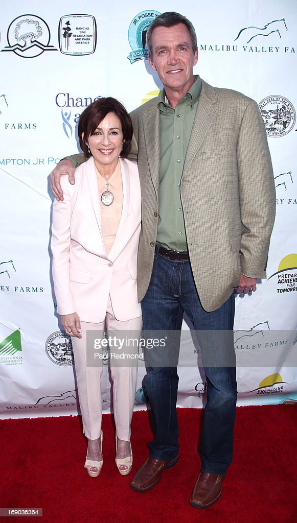Actors <a gi-track='captionPersonalityLinkClicked' href=/galleries/search?phrase=Patricia+Heaton&family=editorial&specificpeople=173459 ng-click='$event.stopPropagation()'>Patricia Heaton</a> and <a gi-track='captionPersonalityLinkClicked' href=/galleries/search?phrase=Neil+Flynn&family=editorial&specificpeople=556309 ng-click='$event.stopPropagation()'>Neil Flynn</a> arrives at the 6th Annual Compton Jr. Posse Gala at Los Angeles Equestrian Center on May 18, 2013 in Los Angeles, California.