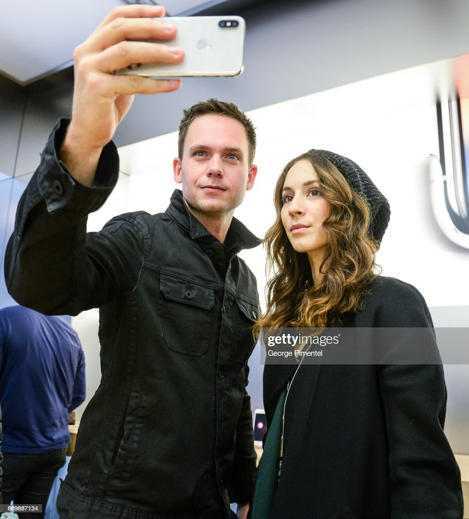Actors Patrick Adams and Troian Bellisario stop by Apple Store Eaton Centre in Toronto for new iPhone X at Apple Store Eaton Centre on November 3, 2017 in Toronto, Canada.