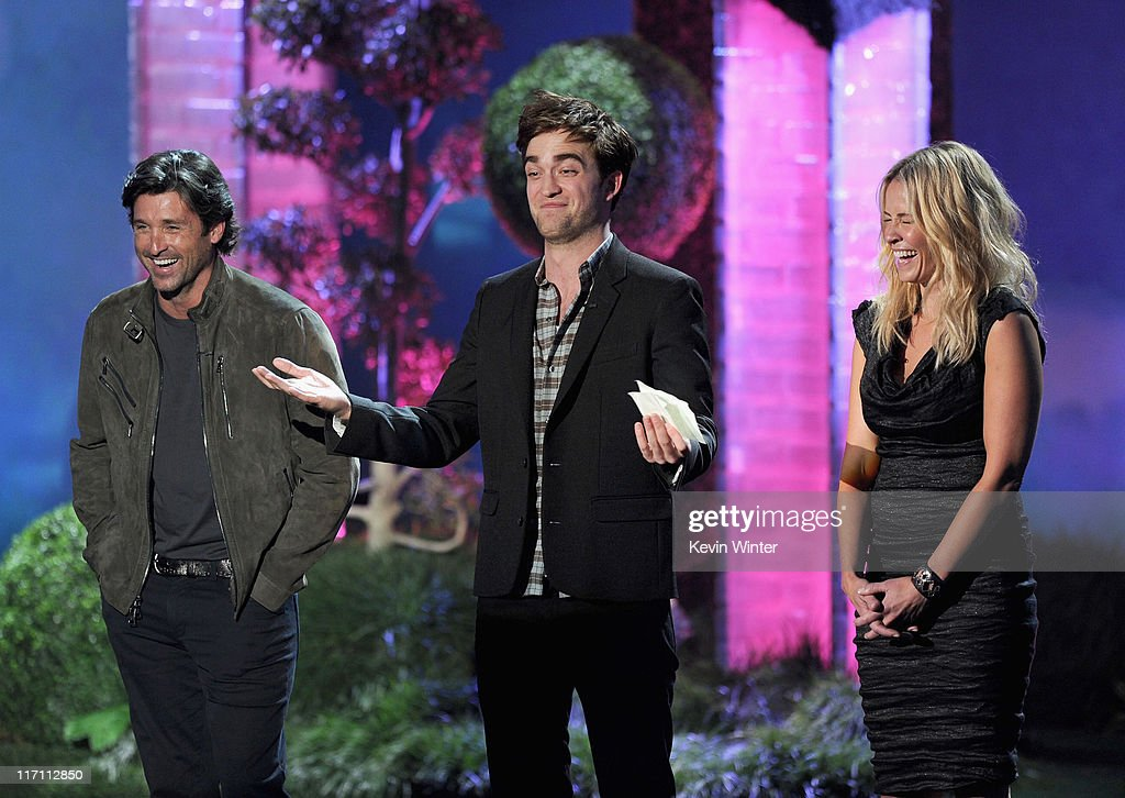 Actors <a gi-track='captionPersonalityLinkClicked' href=/galleries/search?phrase=Patrick+Dempsey&family=editorial&specificpeople=241264 ng-click='$event.stopPropagation()'>Patrick Dempsey</a>, <a gi-track='captionPersonalityLinkClicked' href=/galleries/search?phrase=Robert+Pattinson&family=editorial&specificpeople=734445 ng-click='$event.stopPropagation()'>Robert Pattinson</a>, and <a gi-track='captionPersonalityLinkClicked' href=/galleries/search?phrase=Chelsea+Handler&family=editorial&specificpeople=599162 ng-click='$event.stopPropagation()'>Chelsea Handler</a> speak onstage during the 2011 MTV Movie Awards at Universal Studios' Gibson Amphitheatre on June 5, 2011 in Universal City, California.