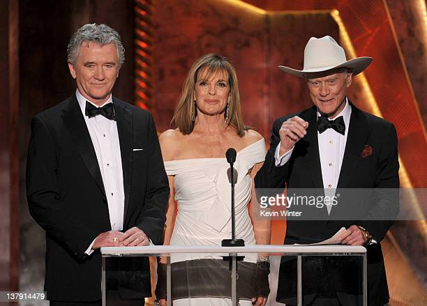 Actors Patrick Duffy Linda Gray and Larry Hagman speak onstage during the 18th Annual Screen Actors Guild Awards at The Shrine Auditorium on January...