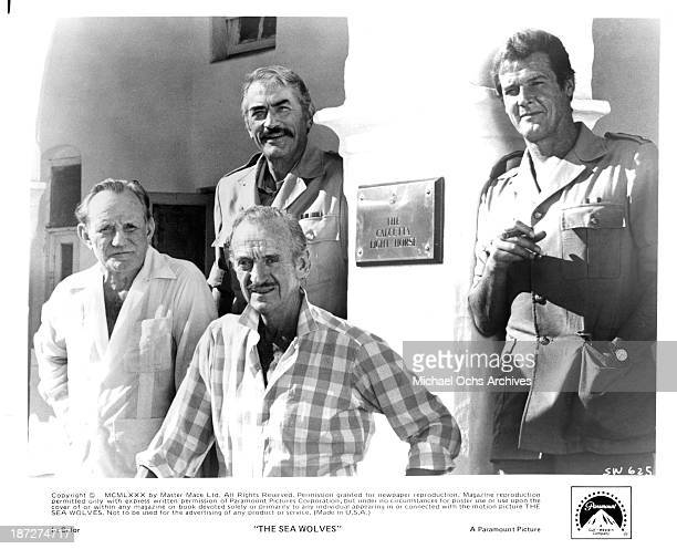 Actors Patrick Macnee Gregory Peck David Niven and Roger Moore on set of the Paramount Pictures movie 'The Sea Wolves' 1980