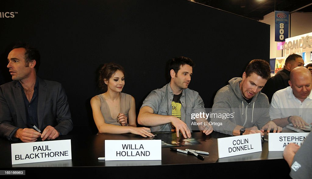 Actors Paul Blackthorne, Colin Donnell, Willa Holland, Stephen Amell and writer Marc Guggenheim of The WB's 'Arrow' signs autographs at the DC Comics booth at WonderCon Anaheim 2013 - Day 3 held at Anaheim Convention Center on March 31, 2013 in Anaheim, California.