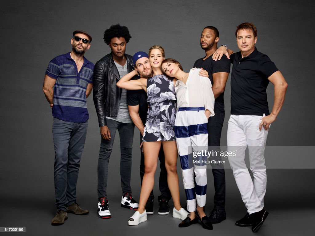 Actors Paul Blackthorne, Echo Kellum, Stephen Amell, Emily Bett Rickards, Willa Holland, David Ramsey and John Barrowman from 'Arrow' are photographed for Entertainment Weekly Magazine on July 23, 2016 at Comic Con in the Hard Rock Hotel in San Diego, California.