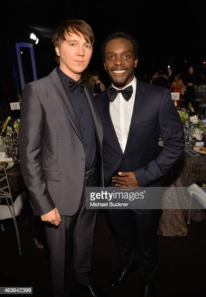 Actors Paul Dano and Chris Chalk attend 20th Annual Screen Actors Guild Awards at The Shrine Auditorium on January 18 2014 in Los Angeles California